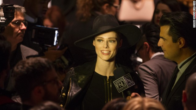 Model Coco Rocha is interviewed on the runway prior to Herve Leger show.