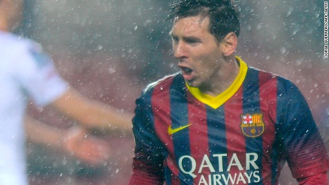 A soaked but happy Lionel Messi after scoring one of his two goals in Barcelona