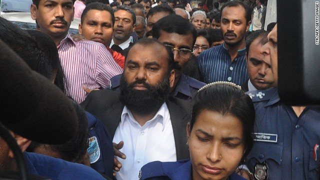 Delwar Hossain, owner of Tazreen Fashions, is escorted into court on Feb 9