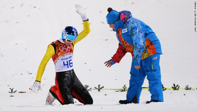 Severin Freund of Germany acknowledges the crowd after crashing during the men's normal hill ski jump event on February 9.