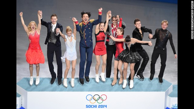 The Russian figure skating team celebrates on the podium after winning the gold medal February 9.