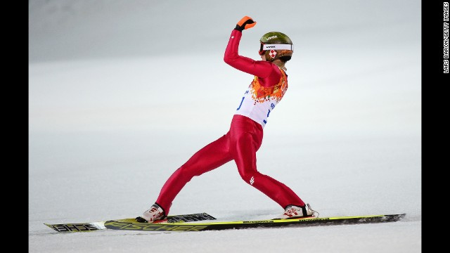 Kamil Stoch of Poland celebrates his gold-medal performance in the normal hill ski jumping event February 9.