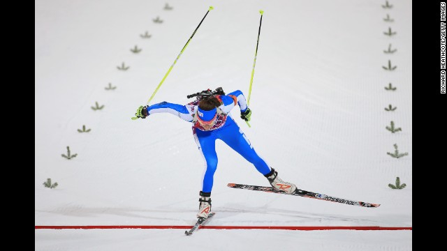 Biathlete Dorothea Wierer of Italy crosses the finish line in the women's 7.5-kilometer sprint on February 9.