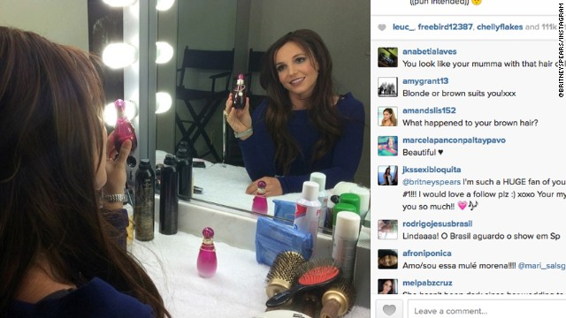 Britney Spears sent out an image on Instagram showing her latest look -- transforming her blond locks to brunette.