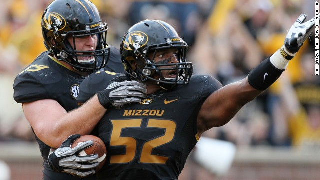 Sam is congratulated by teammate Matt Hoch after returning a fumble for a touchdown against Southeastern Louisiana on September 1 in Columbia, Missouri.