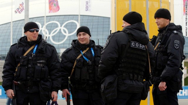Russian police officers patrol the Olympic Park in Sochi on Sunday, February 9.