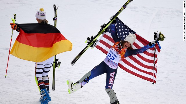 Germany's Maria Hoefl-Riesch, left and U.S. skier Julia Mancuso pose by the podium after the super-combined event on February 10. Hoefl-Riesch won gold and Mancuso won bronze.