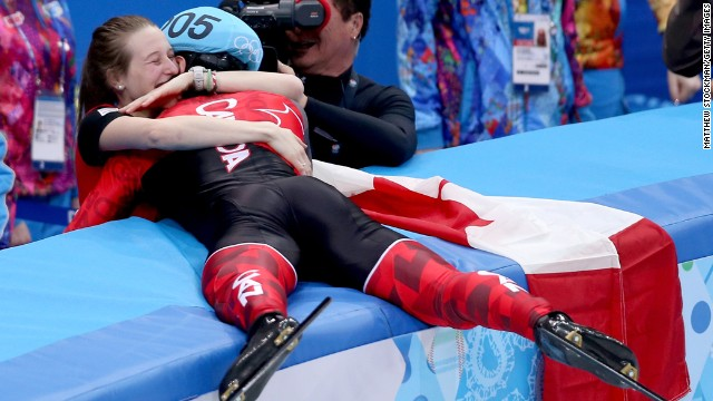 Charles Hamelin of Canada celebrates with his girlfriend, Marianne St-Gelais, after winning the 1,500-meter race in short track speedskating February 10.