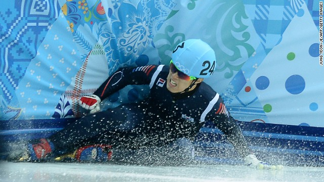 South Korea's Sin Da-Woon falls as he competes in the 1,500-meter short track semifinals on February 10.