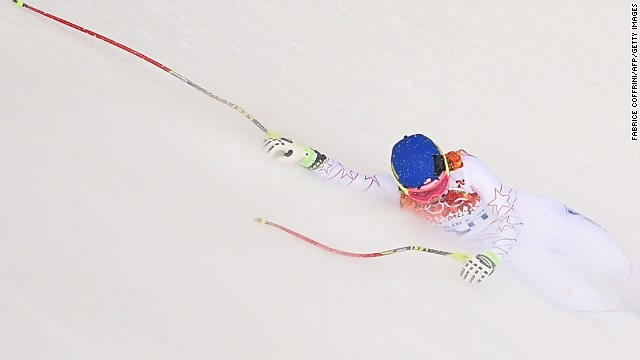 U.S. skier Laurenne Ross falls during the downhill portion of the super-combined event on February 10.