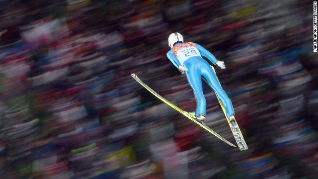 Janne Ahonen of Finland flies in the air during the men's normal hill ski jumping event on Sunday, February 9.