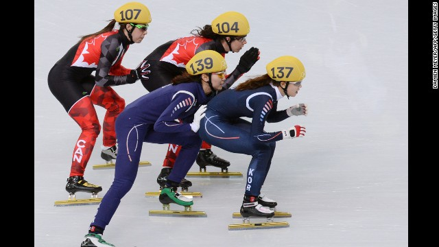 South Korea's Shim Suk-Hee, front left, South Korea's Kong Sangjeong, front right, Canada's Valerie Maltais, back left, and Canada's Marie-Eve Drolet compete in the 3,000-meter short track relay February 10.