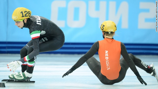 The Netherlands' Sanne van Kerkhof, right, falls next to Italy's Lucia Peretti as they compete in the 3,000-meter short track relay February 10.