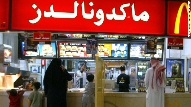 A segregation board separates men and women at a McDonald's in Riyadh in 2004. Restaurants in Saudi Arabia are divided into a family section and a section for men.