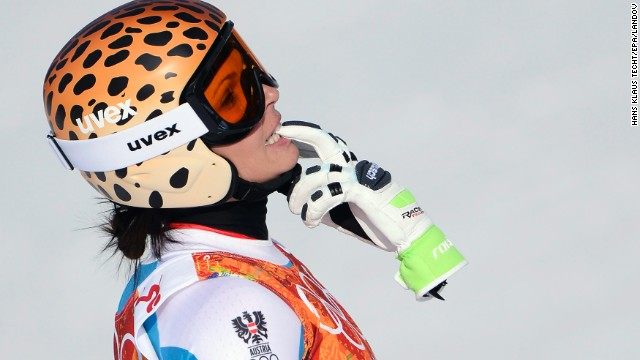 Anna Fenninger of Austria holds one of her gloves after her downhill run in the super-combined event.
