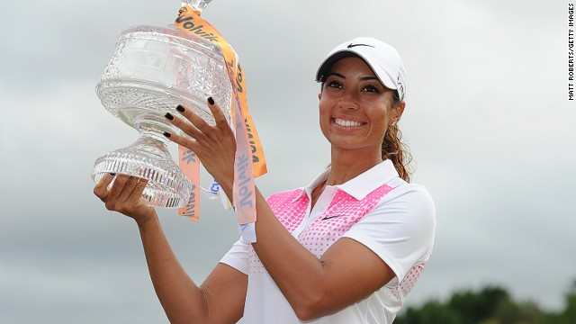 Cheyenne Woods hold the Australian Ladies Masters trophy aloft following her victory on Queensland's Gold Coast on Sunday.