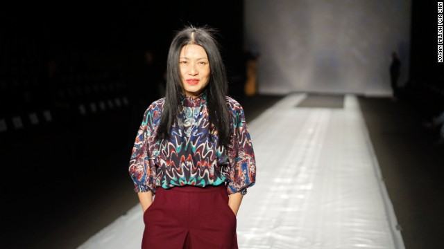 Vivienne Tam showed her collection on February 9. Here, the designer is seen fine-tuning details before her big show.