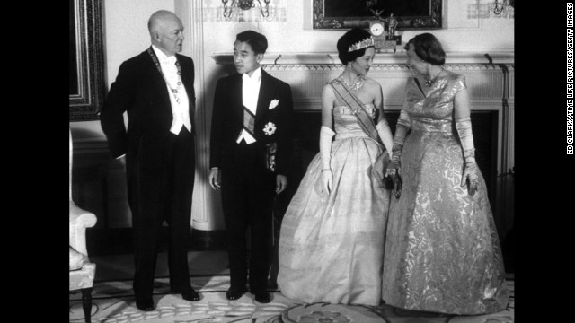 President Dwight Eisenhower and his wife, Mamie, talk with Japan's Prince Akihito and Princess Michiko at the White House for a state dinner on September 27, 1960.