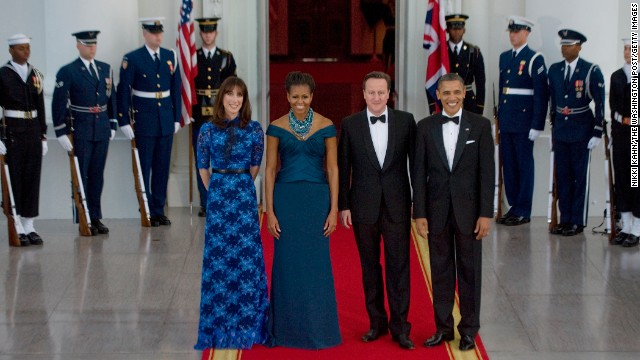 President Barack Obama and first lady Michelle Obama welcome British Prime Minister David Cameron and his wife, Samantha Cameron, before a state dinner on March 14, 2012.