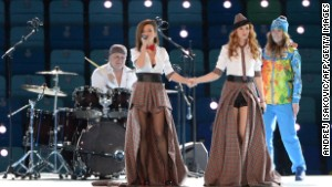 Yulia Volkova and Lena Katina of t.A.T.u. perform during the Opening Ceremony of the Sochi Winter Olympics.