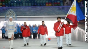 Philippines\' flag bearer, Michael Christian Martinez, leads his national delegation during the Opening Ceremony of the 2014 Sochi Winter Olympics.