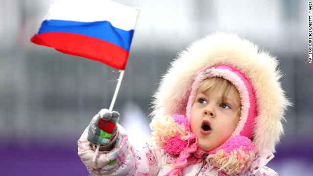 A young child waves a Russian flag on February 10.