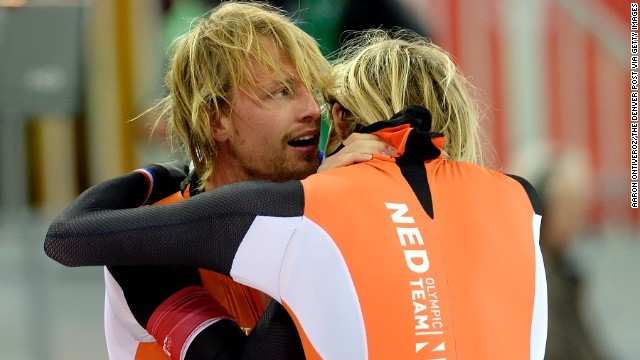 Twins Michel and Ronald Mulder of the Netherlands hug after the 500-meter speedskating event on February 10. Michel won the event, and Ronald finished third.