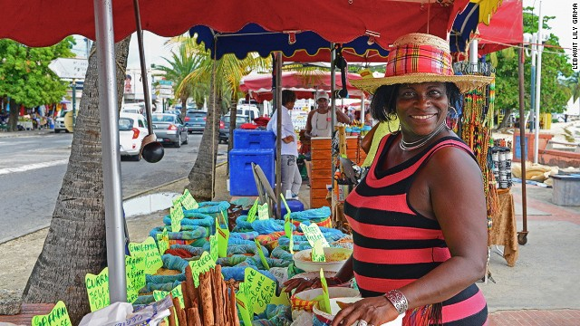Colorful spices compete with bottles of homemade fruit rum punch, bright as a painter's palette. On Grande-Terre, St. Anne's beachfront market is a local favorite.
