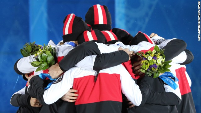 Canada's figure skating team celebrates winning silver on February 10.