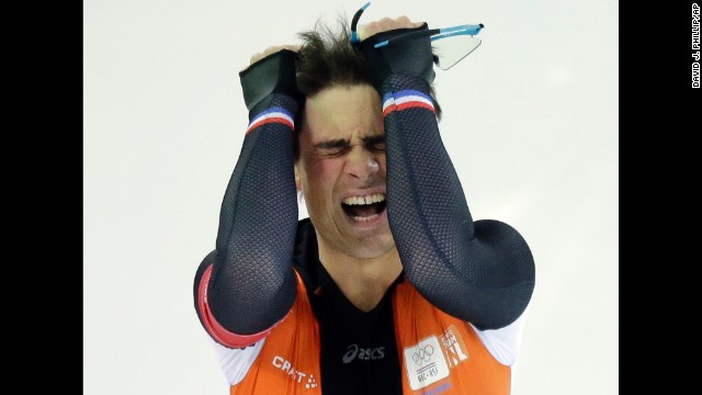 Jan Smeekens of the Netherlands pulls his hair after completing his second heat in the men's 500-meter speedskating race on February 10.