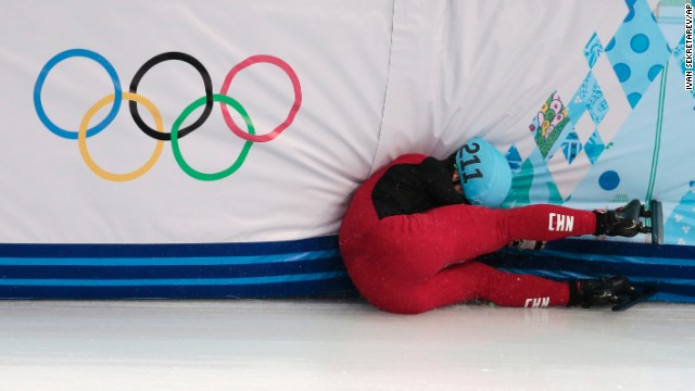 Speedskater Shi Jingnan of China crashes in a men's 1,500-meter short track race on February 10.