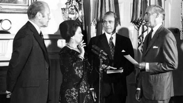 Temple Black is sworn in as new chief of protocol beside President Gerald R. Ford in the Cabinet Room of the White House in 1976.