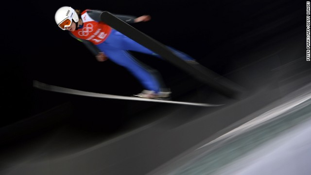 France's Julia Clair practices February 11 for the women's normal hill ski jumping event.