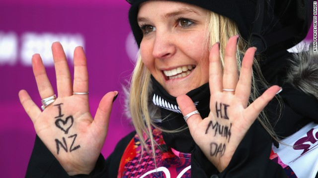 Skier Anna Willcox-Silfverberg of New Zealand holds up messages written on her hands during the slopestyle qualification.