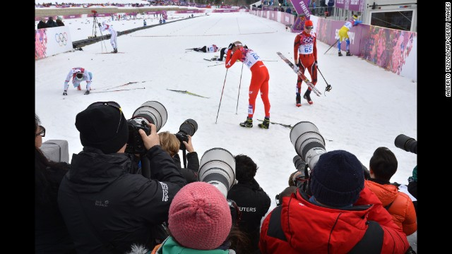 Photographers gather at the finish line February 11 during a qualification race for the men's cross-country sprint.