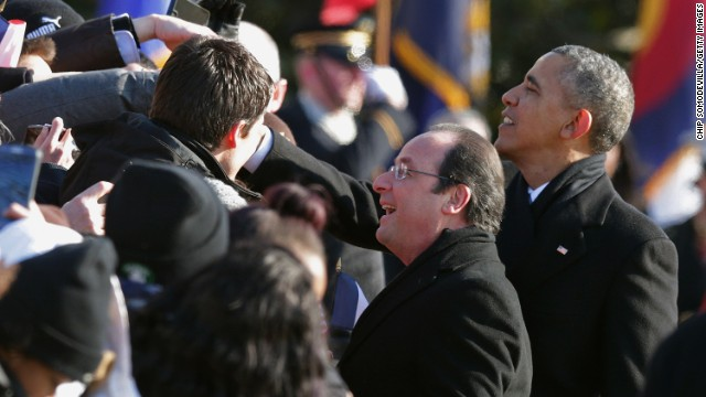 Obama and Hollande greet guests during welcoming ceremonies on February 11.