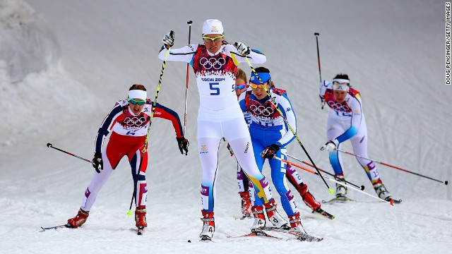 Ida Ingemarsdotter of Sweden leads a pack of skiers in the women's cross-country sprint on February 11.