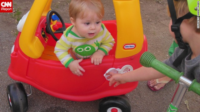 """I'm out of gas! Can someone give me a push?"" -- Owen Flemming Banks, age 11 months, hopes to get a push from 4-year-old brother, Mason."