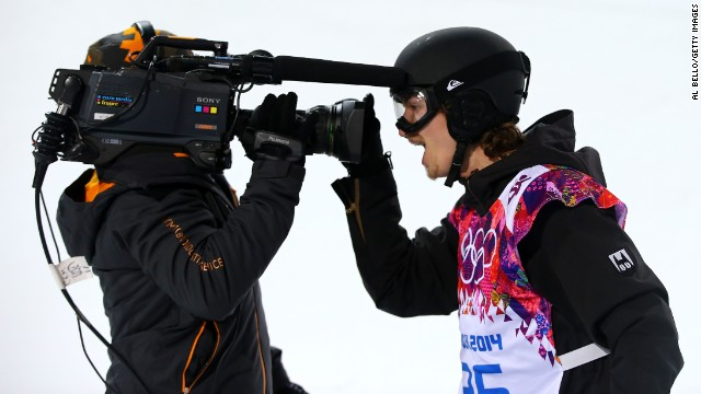 Snowboarder Iouri Podladtchikov of Switzerland celebrates in front of a TV camera after competing in the men's halfpipe on February 11.