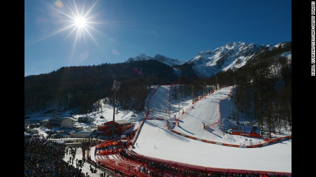 Skiers slide toward the finish line of the women's downhill event February 12.