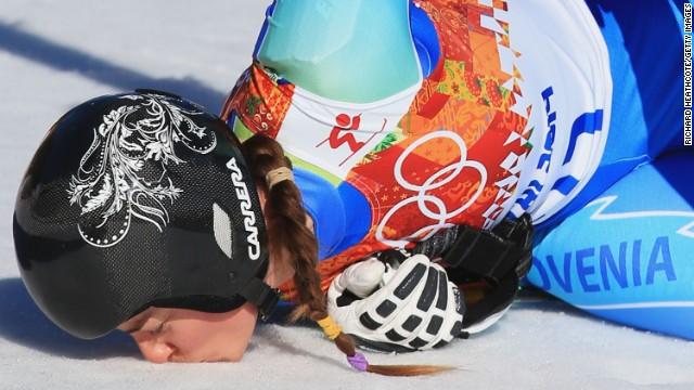 But so did Tina Maze of Slovenia, who is shown kissing the ground after her run.
