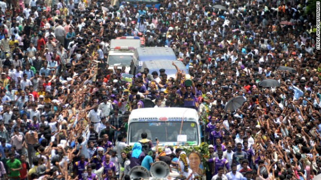 Kolkata Knight Riders players and officials ride on a truck with the IPL tournament trophy during a victory procession to the Eden Gardens in Kolkata on May 29, 2012.