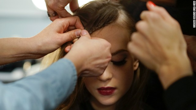 A model gets her hair styled before Nanette Lepore's show.