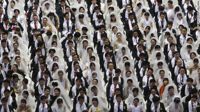 FEBRUARY 12 - GAPYEONG, SOUTH KOREA: Some 2,500 South Korean and foreign couples exchange or reaffirm marriage vows in a mass wedding ceremony arranged by Hak Ja Han Moon, the wife of the late Rev. Sun Myung Moon, the<a href='http://edition.cnn.com/2012/09/02/world/asia/south-korea-reverend-moon-dead/'> controversial founder of the Unification Church</a>.