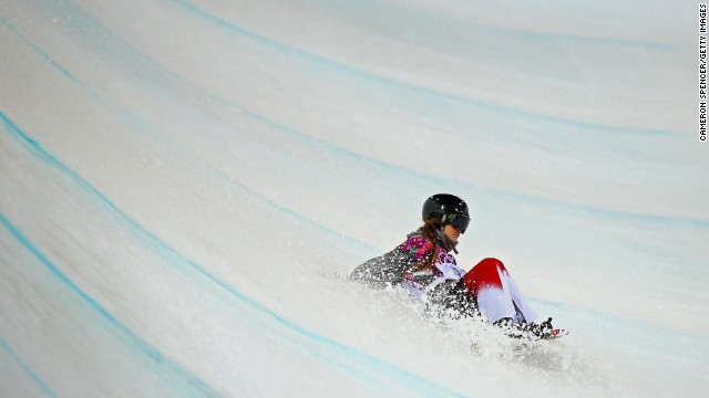 Snowboarder Alexandra Duckworth of Canada crashes out in the women's halfpipe semifinals on February 12.