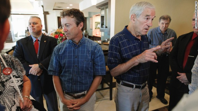 2012 Republican presidential candidate, Rep. Ron Paul, R-Texas, and Rand Paul, his son, speak with supporters before the start of a campaign event in Ames, Iowa, in August 2011.