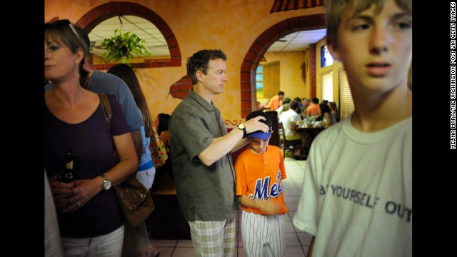 Rand Paul waits for a table at a Mexican restaurant with his sons, Robert, 11, and Duncan, 14, in May 2010 in Bowling Green, Kentucky.
