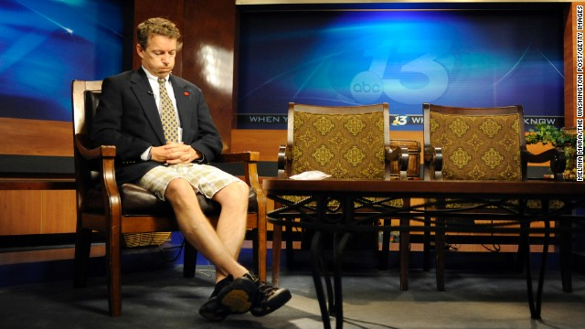 In shorts and a suit jacket fresh from his son's soccer game, Rand Paul waits to be a guest on a Fox News program in May 2010 in Bowling Green, Kentucky.