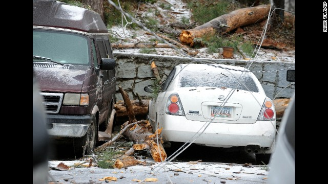 A downed power line lays across several vehicles in Atlanta on February 12.