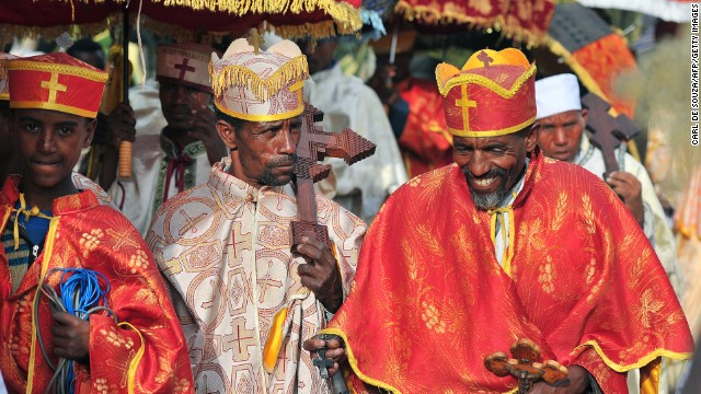 On the eve of Timket, Ethiopian Orthodox Christian priests prepare sacred replicas of the Ark of the Covenant -- the chest that carried the 10 Commandments -- and parade them in a slow procession to the Fasilides Bath.